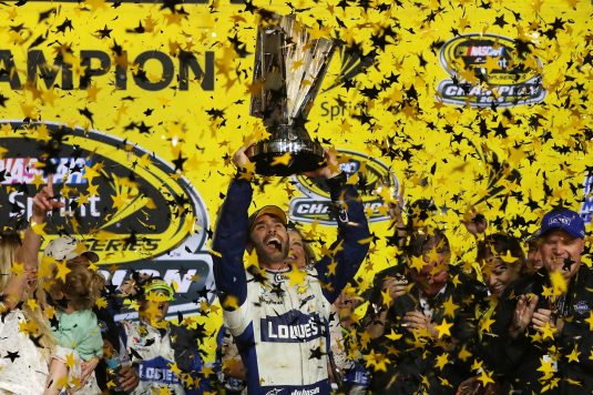 HOMESTEAD, FL - NOVEMBER 20:  Jimmie Johnson, driver of the #48 Lowe's Chevrolet, celebrates with the NASCAR Sprint Cup Series Championship trophy in Victory Lane after winning the NASCAR Sprint Cup Series Ford EcoBoost 400 and the 2016 NASCAR Sprint Cup Series Championship at Homestead-Miami Speedway on November 20, 2016 in Homestead, Florida. Johnson wins a record-tying 7th NASCAR title.  (Photo by Sean Gardner/NASCAR via Getty Images)